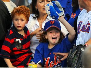 Mets fans cry at the end of the game when the New York Mets played the Houston Astros October 4, 2009 at Citi Field in Flushing Meadows in Queens, NY. The Mets beat the Astros 4-0 in their last season game at the park. METS V HOUSTON CITIFEILD S Original Filename: nymvhousabo00885.JPG